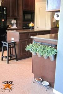 Kitchen rail turned hanging planter