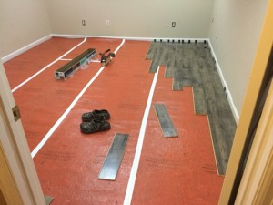 Our first DIY project – laminate flooring in Ben's basement office