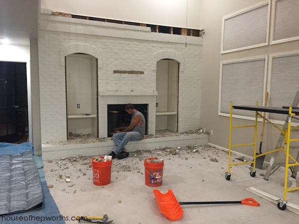 Knocking down a huge brick fireplace wall