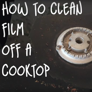 How to clean baked-on film off a glass cooktop